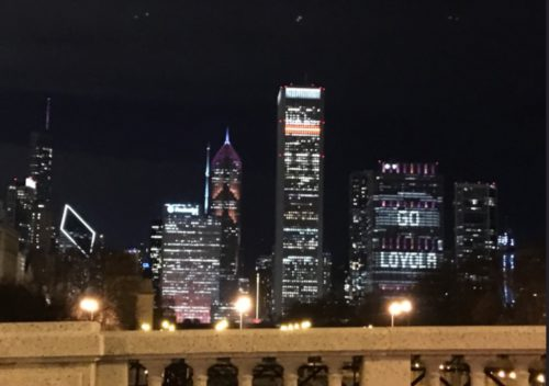 The Chicago skyline lit in maroon and gold supporting Loyola in the NCAA Final Four.